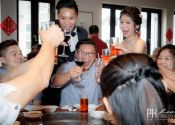 Ben & Winly Actual Day Wedding table guests toasting Photography @ Spring Court Restaurant 09